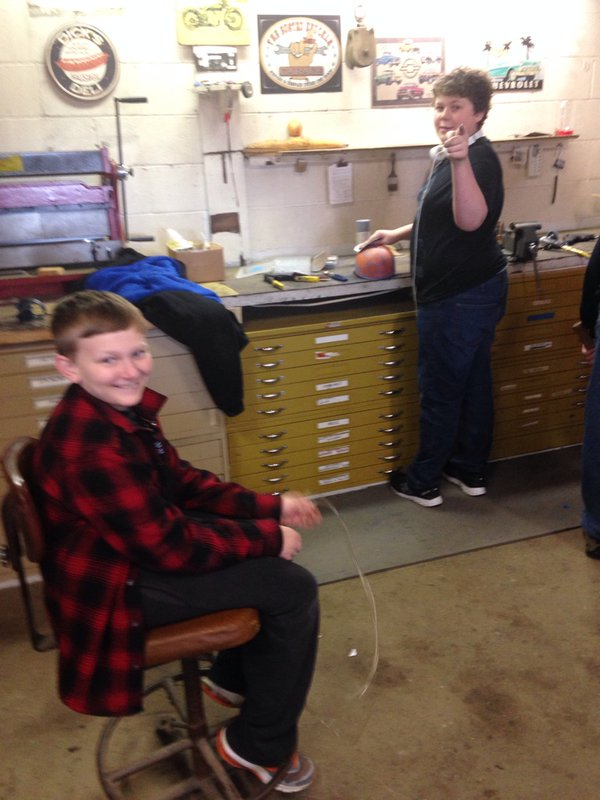 Connor and Wyatt working on their own project in the shop.
